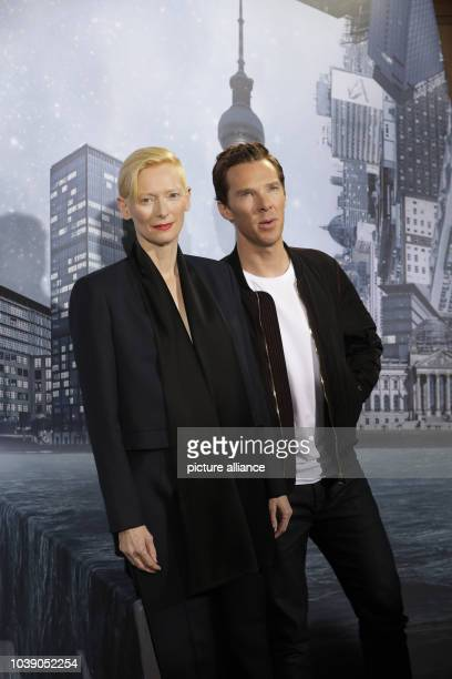 Actors Tilda Swinton and Benedict Cumberbatch stand during a photocall for the film 'Doctor Strange' in Berlin Germany 26 October 2016...