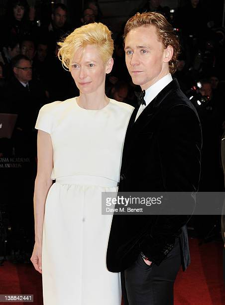 Actors Tilda Swinton and Tom Hiddleston arrive at the Orange British Academy Film Awards 2012 at The Royal Opera House on February 12 2012 in London...
