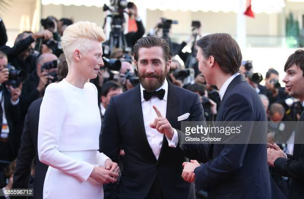 Actors Tilda Swinton Jake Gyllenhaal Paul Dano and Steven Yeun attends the 'Okja' screening during the 70th annual Cannes Film Festival at Palais des...