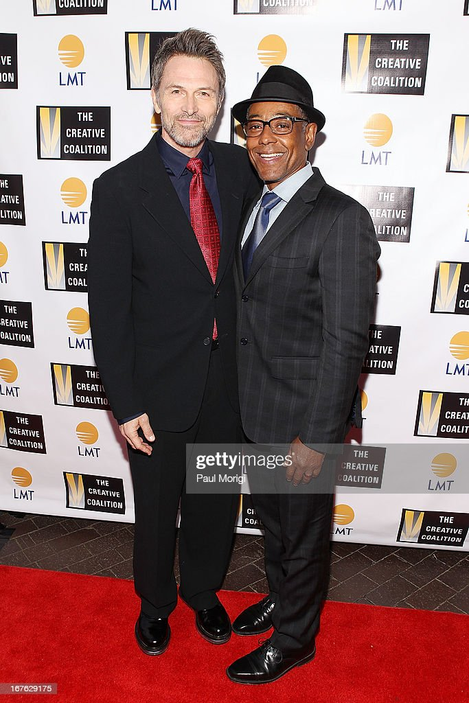 Actors Tim Daly (L) and Giancarlo Esposito attend the Celebrating The Arts In American Dinner Party With Distinguished Women In Media Presented By Landmark Technology Inc. And The Creative Coalition at Neyla on April 26, 2013 in Washington, DC.