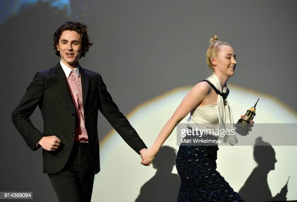 Actors Timothee Chalamet and Saoirse Ronan onstage at the Santa Barbara Award Honoring Saoirse Ronan Presented By UGG during The 33rd Santa Barbara...
