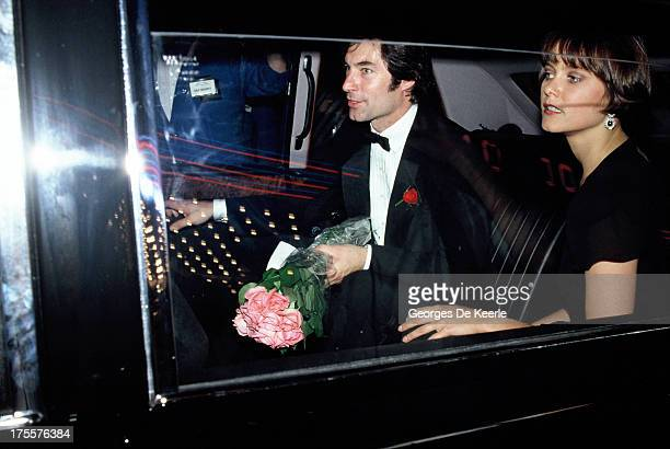 Actors Timothy Dalton and Carey Lowell arrive in their car at the premiere of the James Bond film 'License to Kill' at the Odeon cinema on June 13...