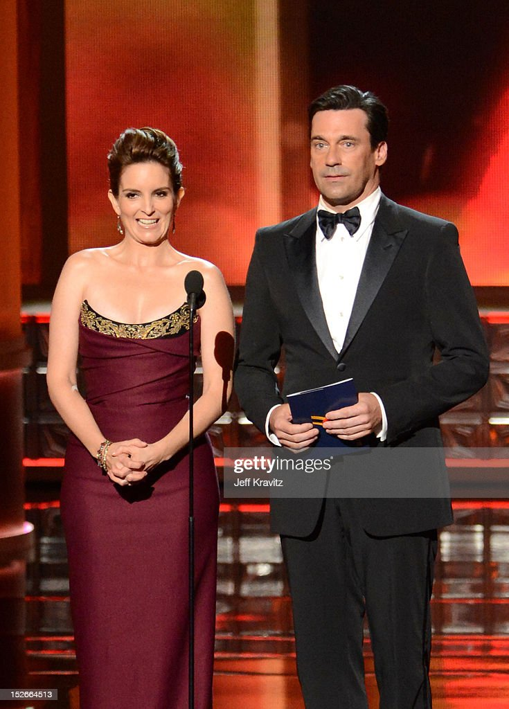 Actors Tina Fey (L) and Jon Hamm onstage during the 64th Primetime Emmy Awards at Nokia Theatre L.A. Live on September 23, 2012 in Los Angeles, California.