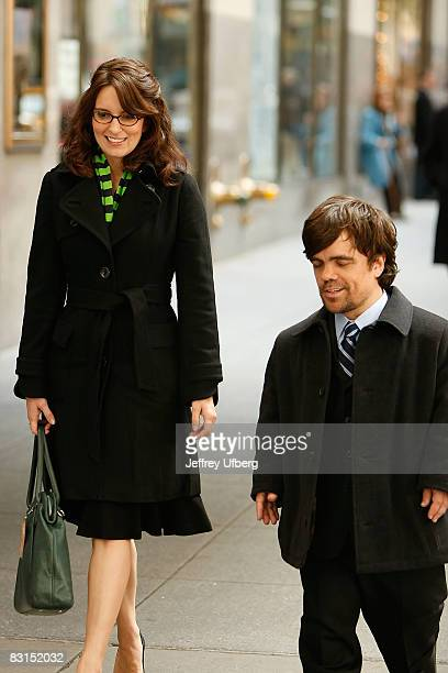 Actors Tina Fey and Peter Dinklage stand on location during filming for '30 Rock' at Rockefeller Center on October 6 2008 in New York City