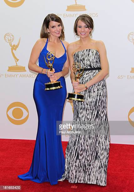 Actors Tina Fey and Tracey Wigfield pose in the press room at the 65th annual Primetime Emmy Awards at Nokia Theatre LA Live on September 22 2013 in...