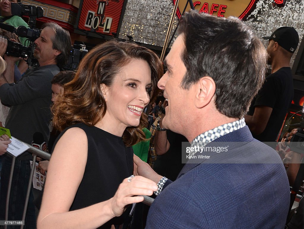 Actors Tina Fey and Ty Burrell arrive for the premiere of Disney's 'Muppets Most Wanted' at the El Capitan Theatre on March 11, 2014 in Hollywood, California.