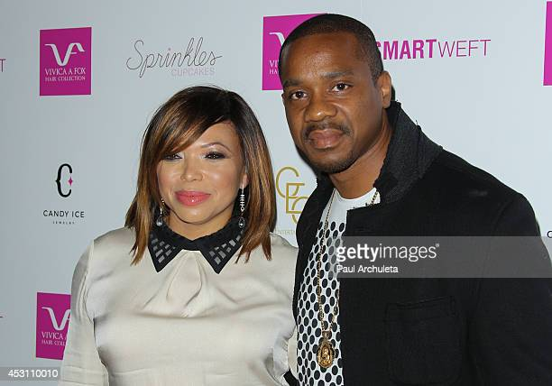 Actors Tisha Campbell and Duane Martin attends Vivica A Fox's 50th birthday celebration at Philippe Chow on August 2 2014 in Beverly Hills California