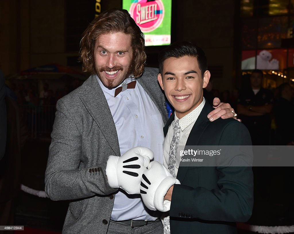 Actors T.J. Miller (L) and Ryan Potter attend the premiere of Disney's 'Big Hero 6' at the El Capitan Theatre on November 4, 2014 in Hollywood, California.