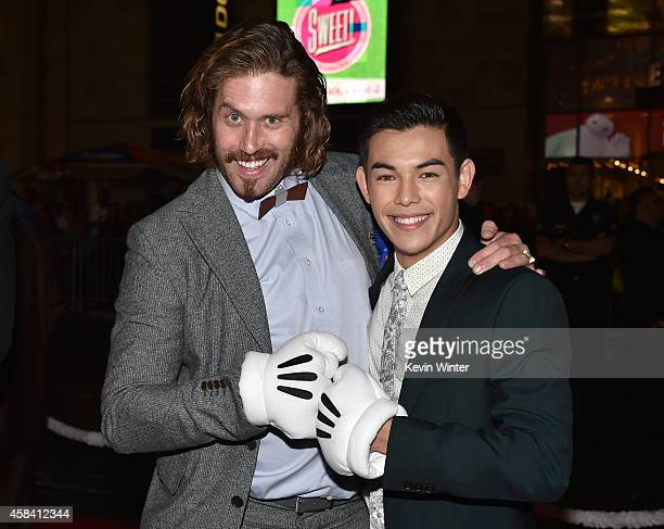 Actors TJ Miller and Ryan Potter attend the premiere of Disney's Big Hero 6 at the El Capitan Theatre on November 4 2014 in Hollywood California