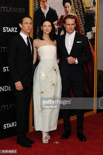 Actors Tobias Menzies Caitriona Balfe and Sam Heughan attend the Outlander Season 2 Premiere on April 4 2016 in New York City