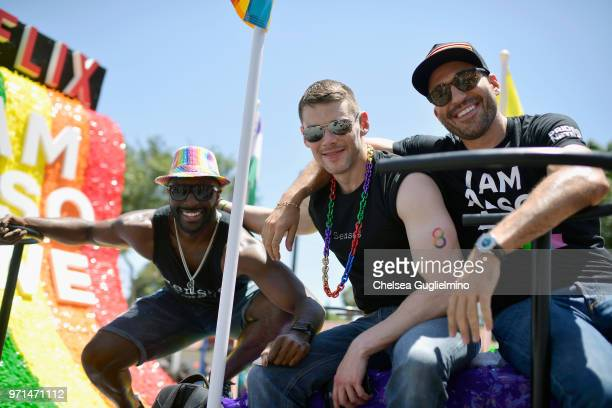 Actors Toby Onwumere Brian Smith and Miguel Angel Silvestre pose on the Netflix original series 'Sense8' float at the LA Pride Parade 2018 on June 10...