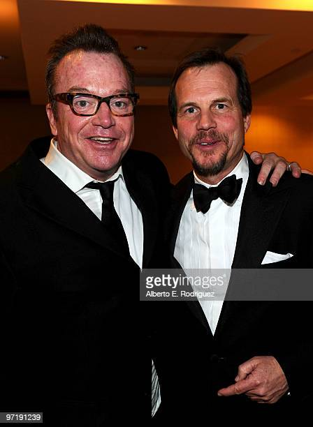 Actors Tom Arnold and Bill Paxton pose at the 8th annual VES Awards held at Hyatt Regency Century Plaza on February 28 2010 in Century City California