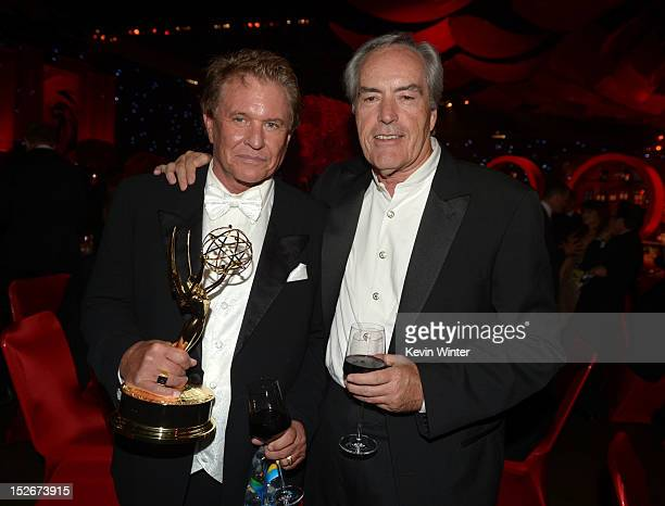 Actors Tom Berenger and Powers Boothe attend the 64th Annual Primetime Emmy Awards Governors Ball at Nokia Theatre LA Live on September 23 2012 in...