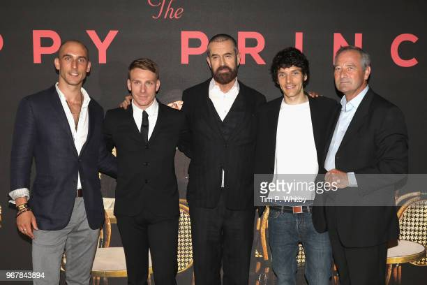 Actors Tom Colley Edwin Thomas Director Rupert Everett and actors Colin Morgan and Julian Wadham attend the UK premiere of 'The Happy Prince' at Vue...
