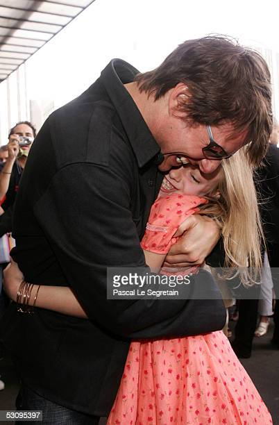 Actors Tom Cruise and Dakota Flanning embrace at the Gare de Lyon railway station ahead of the French premiere of the new film 'War Of The Worlds'...