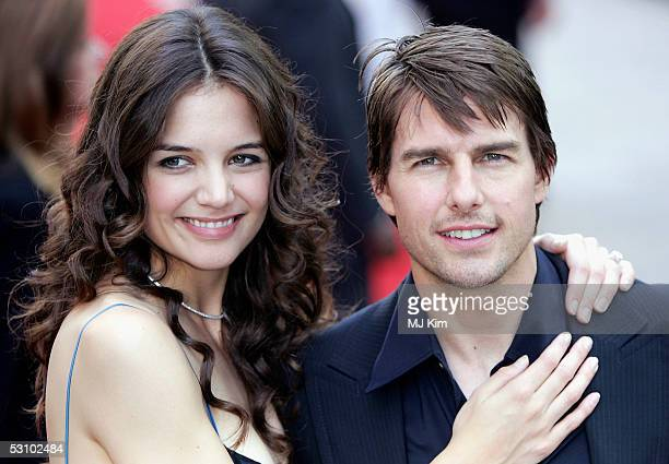 Actors Tom Cruise and fiancee Katie Holmes arrive for the UK Premiere of his new blockbuster War Of The Worlds at the Odeon Leicester Square on June...