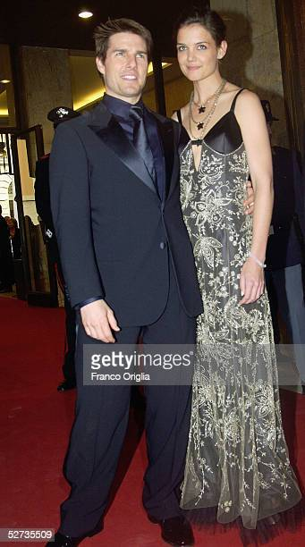 Actors Tom Cruise and girlfriend Katie Holmes arrive at the David di Donatello Award ceremony to receive the Special David by Bulgari April 29 2005...