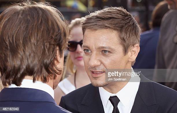 Actors Tom Cruise and Jeremy Renner attends the 'Mission Impossible Rogue Nation' New York premiere at Times Square on July 27 2015 in New York City
