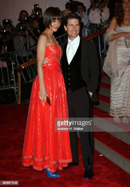 Actors Tom Cruise and Katie Holmes arrive to the Metropolitan Museum of Art Costume Institute Gala, Superheroes: Fashion and Fantasy, held at the...