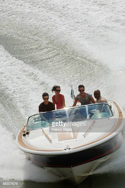 Actors Tom Cruise and Ving Rhames ride on a boat during a break from filming 'Mission Impossible 3' on the Tiber River on July 12 2005 in Rome Italy...