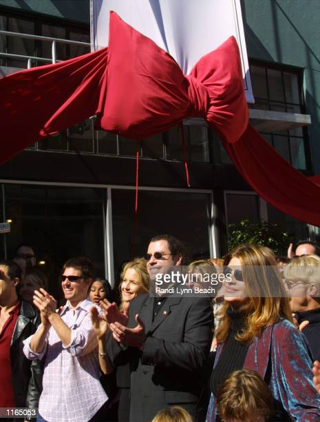 Actors Tom Cruise Kelly Preston John Travolta and Kirstie Alley listen to actress Jenna Elfman speak at the opening of the Church of Scientology...