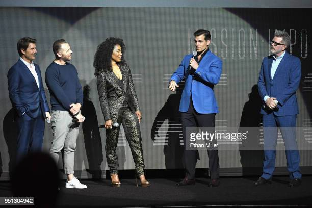 Actors Tom Cruise Simon Pegg Angela Bassett Henry Cavill and director/writer/producer Christopher McQuarrie speak onstage during the CinemaCon 2018...