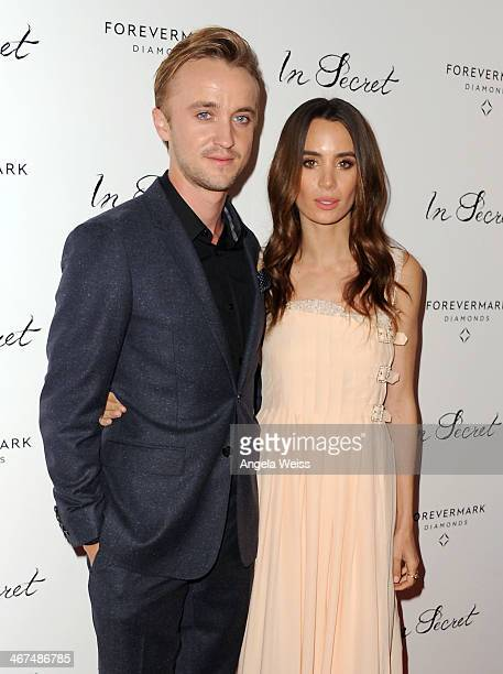 Actors Tom Felton and Jade Olivia arrive at the Los Angeles premiere of 'In Secret' at ArcLight Hollywood on February 6 2014 in Hollywood California