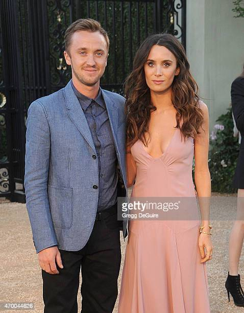 Actors Tom Felton and Jade Olivia attend the Burberry 'London in Los Angeles' event at Griffith Observatory on April 16 2015 in Los Angeles California