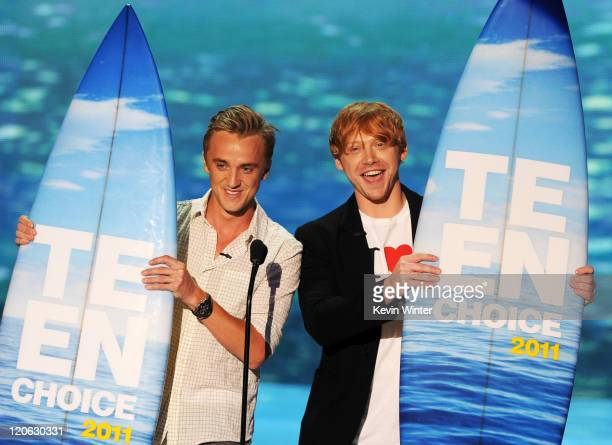Actors Tom Felton and Rupert Grint accept the Harry Potter awards onstage during the 2011 Teen Choice Awards held at the Gibson Amphitheatre on...