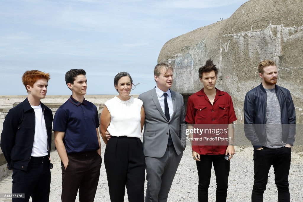 Actors Tom Glynn-Carney, Fionn Whitehead, Producer Emma Thomas, Director Christopher Nolan, Actors Harry Styles and Jack Lowden pose for a photo at the Dunkirk photocall on July 16, 2017 in Dunkerque, France.