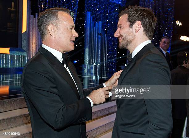 Actors Tom Hanks and Bradley Cooper attend the 20th Annual Screen Actors Guild Awards at The Shrine Auditorium on January 18 2014 in Los Angeles...