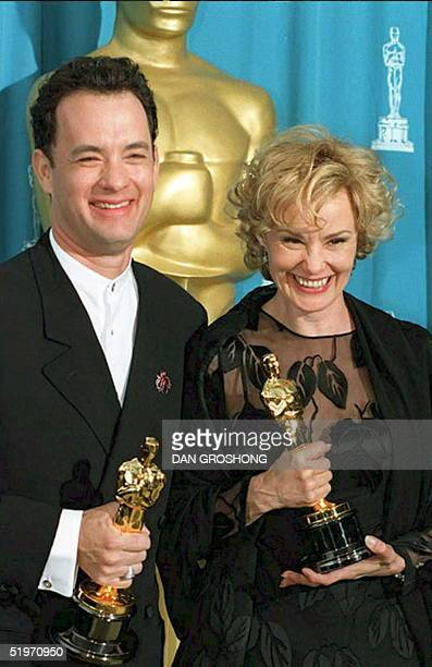 Actors Tom Hanks and Jessica Lange pose with their Oscars at the 67th annual Academy Awards 27 March in Los Angeles. Hanks won as best actor for his...