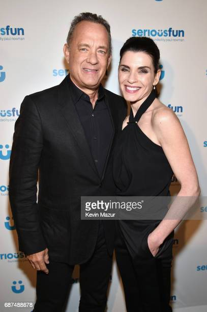 Actors Tom Hanks and Julianna Margulies attend the SeriousFun Children's Network Gala at Pier 60 on May 23 2017 in New York City