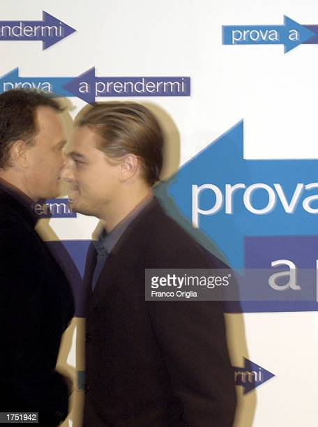 """Actors Tom Hanks and Leonardo DiCaprio attend a promotional viewing of their new film """"Catch Me If You Can"""" at the """"Cinema Adriano"""" January 29, 2003..."""