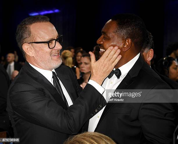 Actors Tom Hanks and Mykelti Williamson attend The 22nd Annual Critics' Choice Awards at Barker Hangar on December 11, 2016 in Santa Monica,...