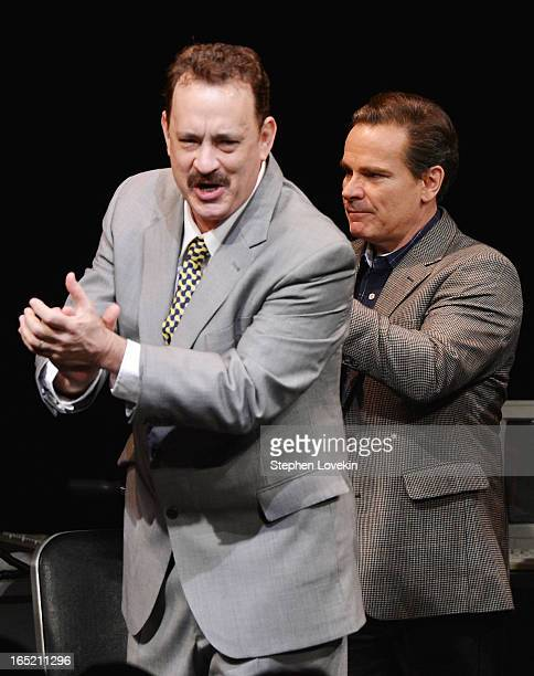 Actors Tom Hanks and Peter Scolari attend the curtain call for the Lucky Guy Broadway opening night at The Broadhurst Theatre on April 1 2013 in New...
