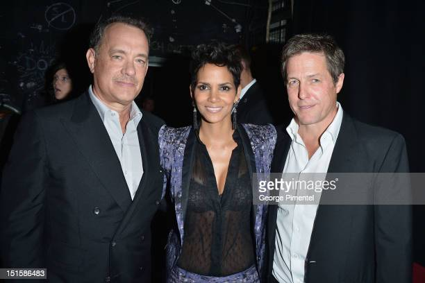 Actors Tom Hanks Halle Berry and Hugh Grant a attends the Cloud Atlas premiere during the 2012 Toronto International Film Festival at the Princess of...