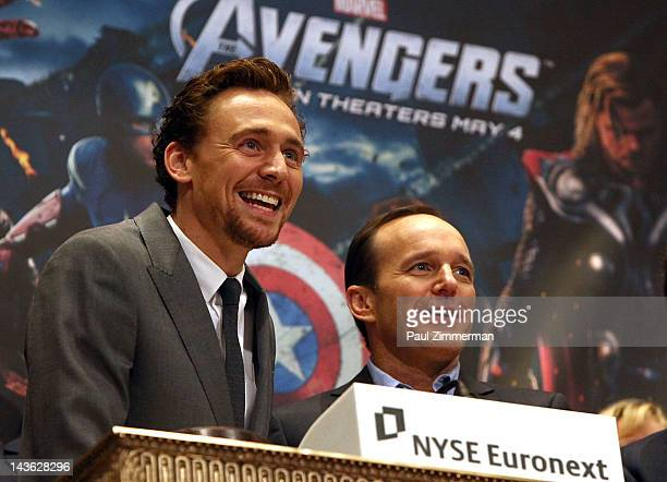 Actors Tom Hiddleston and Clark Gregg ring the opening bell at the New York Stock Exchange on May 1, 2012 in New York City.