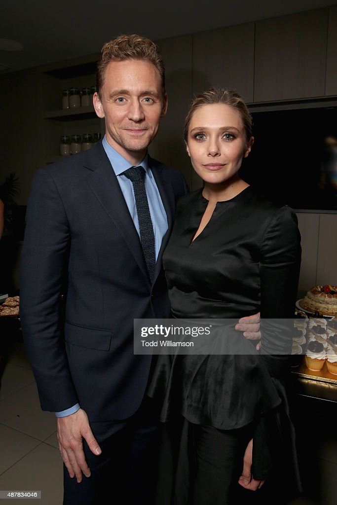 Actors Tom Hiddleston (L) and Elizabeth Olsen attend Sony Pictures Classics after party for 'I Saw The Light' sponsored by Lacoste and Ciroc at The Addison Residence on September 11, 2015 in Toronto, Canada.