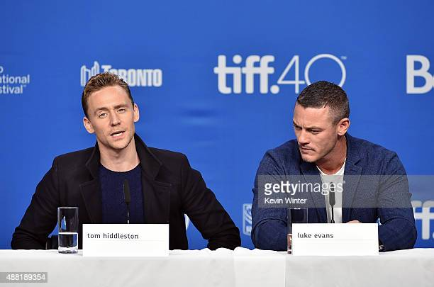 Actors Tom Hiddleston and Luke Evans speak during the HighRise press conference at the 2015 Toronto International Film Festival at TIFF Bell Lightbox...
