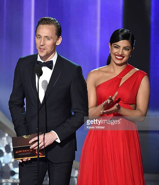 Actors Tom Hiddleston and Priyanka Chopra speak onstage during the 68th Annual Primetime Emmy Awards at Microsoft Theater on September 18 2016 in Los...