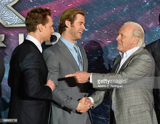 Actors Tom Hiddleston Chris Hemsworth and actor Anthony Hopkins attend Marvel's Thor The Dark World Premiere at the El Capitan Theatre on November 4...