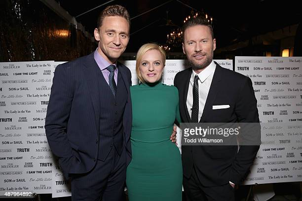 Actors Tom Hiddleston, Elisabeth Moss and composer Brian Tyler attend the SPC Toronto Party during the 2015 Toronto International Film Festival at...