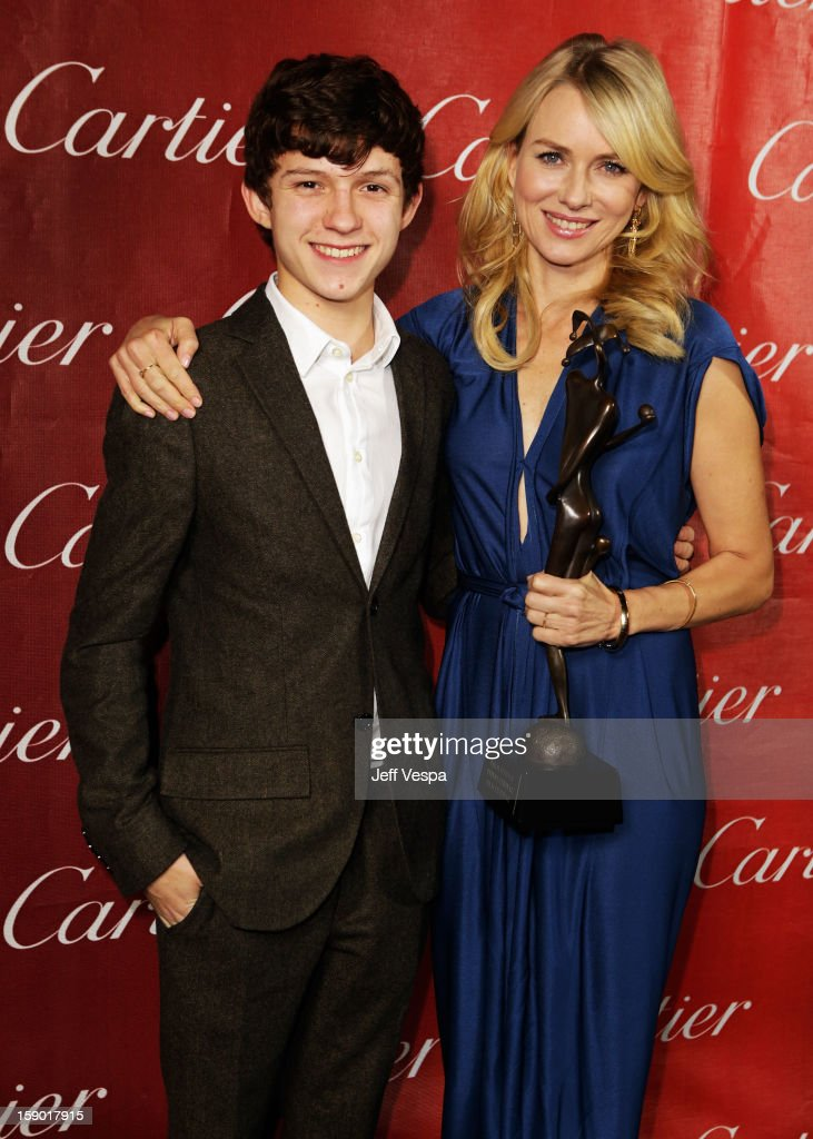 Actors Tom Holland and Naomi Watts pose with the Desert Palm Achievement Award - Actress at the 24th annual Palm Springs International Film Festival Awards Gala at the Palm Springs Convention Center on January 5, 2013 in Palm Springs, California.