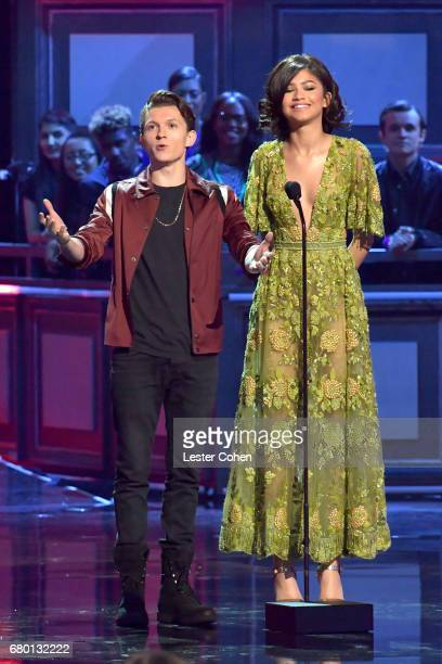 Actors Tom Holland and Zendaya speak onstage during the 2017 MTV Movie And TV Awards at The Shrine Auditorium on May 7 2017 in Los Angeles California