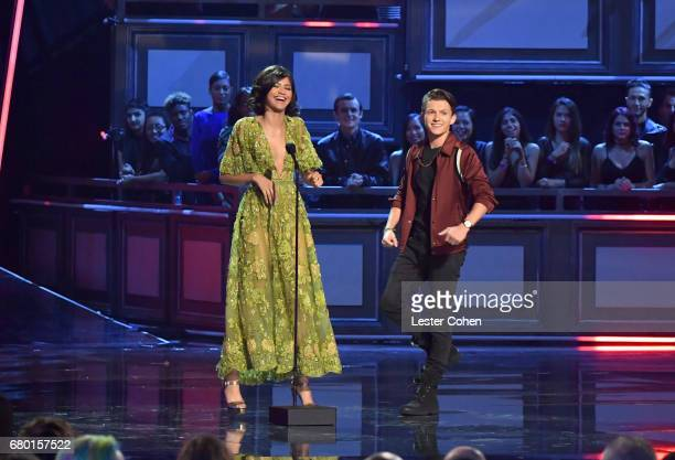 Actors Tom Holland and Zendaya speak onstage during the 2017 MTV Movie And TV Awards at The Shrine Auditorium on May 7, 2017 in Los Angeles,...