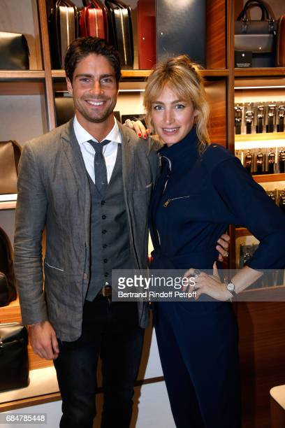 Actors Tom Leeb and Pauline Lefevre attend the Montblanc ChampsElysees Flagship Reopening on May 18 2017 in Paris France