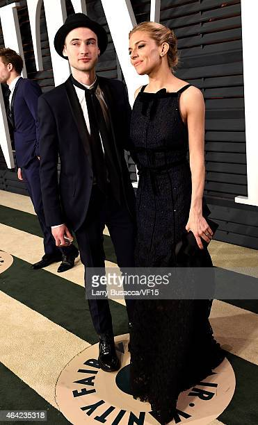 Actors Tom Sturridge and Sienna Miller attend the 2015 Vanity Fair Oscar Party hosted by Graydon Carter at the Wallis Annenberg Center for the...