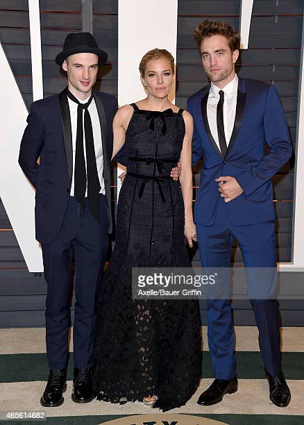 Actors Tom Sturridge Sienna Miller and Robert Pattinson arrive at the 2015 Vanity Fair Oscar Party Hosted By Graydon Carter at Wallis Annenberg...