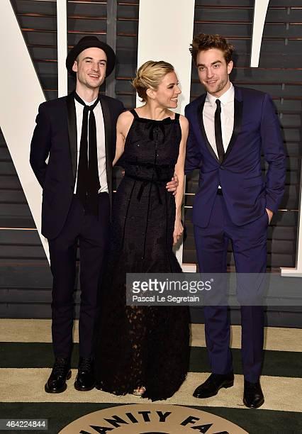 Actors Tom Sturridge Sienna Miller and Robert Pattinson attend the 2015 Vanity Fair Oscar Party hosted by Graydon Carter at Wallis Annenberg Center...